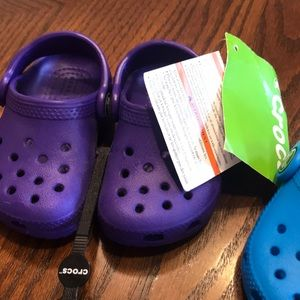 Two pairs of baby crocs size c4 violet and blue